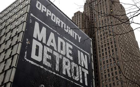 A large ''Opportunity Made In Detroit'' banner is seen on the side of a building in downtown Detroit, Michigan in this January 30, 2013 file photo. Credit: Reuters/Rebecca Cook/Files
