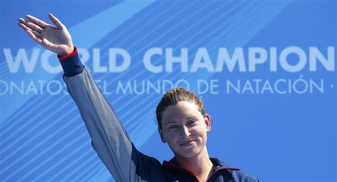 Winner Haley Danita Anderson of the U.S. celebrates on the podium after the women's 5km open water race during the World Swimming Championsh