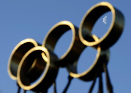 The moon is pictured through a sculpture in front of the International Olympic Committee (IOC) headquarters in Lausanne December 9, 2009. RE