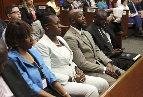 Trayvon Martin's parents Sybrina Fulton and Tracy Martin sit in court as Judge Debra Nelson reads instructions to the jury during George Zim