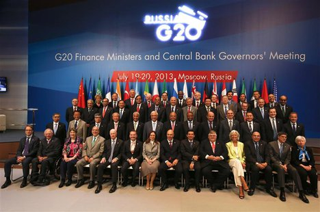 G20 finance ministers and central bank governors pose for a family photo as they meet in Moscow, July 20, 2013. REUTERS/Grigory Dukor