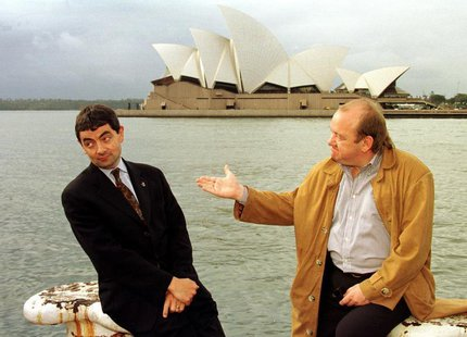 English comedian and actor Rowan Atkinson (L) and compatriot Mel Smith (R) pose for photographers with Sydney's famous landmark the Opera Ho