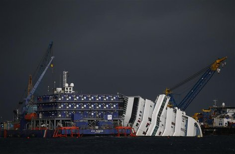 The capsized cruise liner Costa Concordia is surrounded by cranes during a salvage operation in front of Giglio harbour in this January 11,