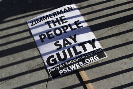 A sign lays on the ground at a protest of the acquittal of George Zimmerman for the 2012 shooting death of Trayvon Martin, in Los Angeles, California July 15, 2013.  Credit: Reuters/Jonathan Alcorn