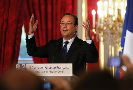French President Francois Hollande delivers a speech during a ceremony to mark the 130th anniversary of the Alliance Francaise, the institut