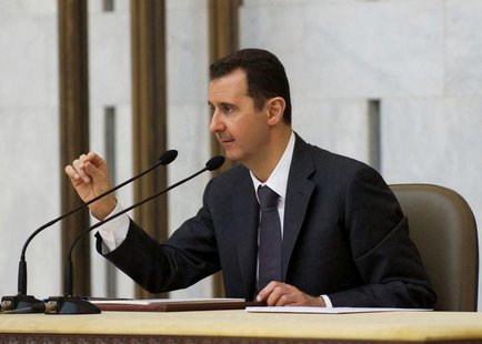 Syria's President Bashar al-Assad heads the plenary meeting of the central committee of the ruling al-Baath party, in Damascus in this hando