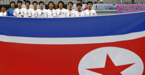 North Korea's national soccer team players sing their national anthem before the Women's East Asian Cup soccer championship match against So