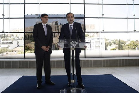 Greece's Prime Minister Antonis Samaras (R) addresses reporters next to U.S. Treasury Secretary Jack Lew at the Athens Acropolis Museum in A