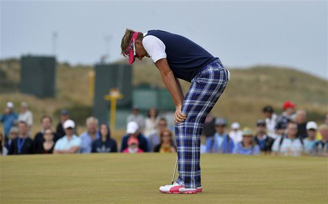 Ian Poulter of England reacts after missing his par putt on the 16th green during the final round of the British Open golf Championship at M