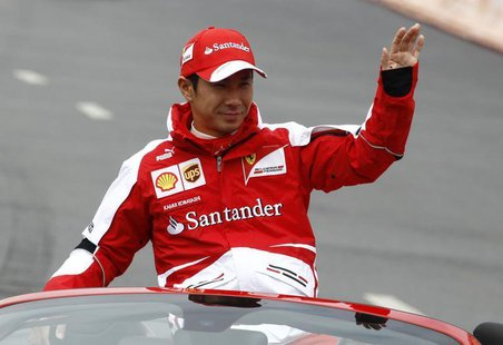 Ferrari Formula One test pilot Kamui Kobayashi waves to spectators during the Moscow City Racing event in Moscow July 21, 2013. REUTERS/Serg
