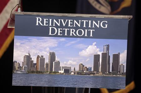 A image of the Detroit skyline is seen on the podium where Detroit Emergency Manager Kevyn Orr and Michigan Governor Rick Snyder addressed the media about filing bankruptcy for the city of Detroit during a news conference in Detroit, Michigan July 19, 2013. Credit: Reuters/ Rebecca Cook