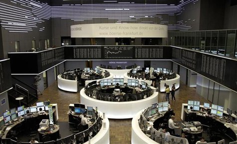 Traders are pictured at their desks in front of the DAX board at the Frankfurt stock exchange July 4, 2013. REUTERS/Remote/Pawel Kopczynski