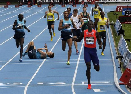 David Rudisha of Kenya (R) wins the men's 800 meters final as Erik Sowiniski of the U.S. (2nd L) falls to the track at the Diamond League Ad