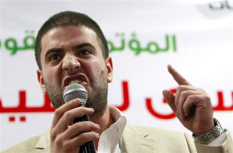 Osama Mohamed Mursi, son of Egypt's ousted President Mohamed Mursi, speaks during a news conference in Cairo July 22, 2013. REUTERS/Mohamed