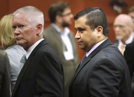 George Zimmerman is escorted from the courtroom a free man after being found not guilty in the 2012 shooting death of Trayvon Martin at the