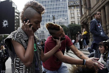 Brazilian punks use their mobile phones during a May Day demonstration on Labour Day in downtown Sao Paulo May 1, 2012. REUTERS/Nacho Doce