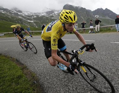 Race leader jersey holder Team Sky rider Christopher Froome of Britain cycles during the 204.5 km stage of the centenary Tour de France cycl