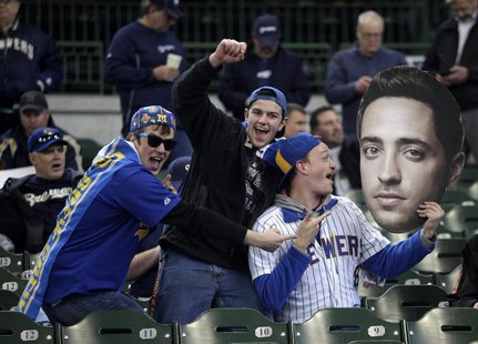 Fans hold up a giant photo of Milwaukee Brewers Ryan Braun before the start of opening day of baseball season as the Milwaukee Brewers take