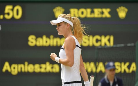 Agnieszka Radwanska of Poland reacts during her women's semi-final tennis match against Sabine Lisicki of Germany at the Wimbledon Tennis Ch