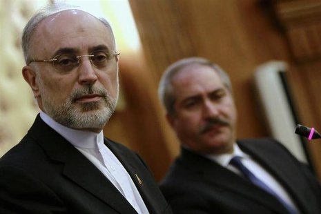 Iran's Foreign Minister Ali Akbar Salehi (L) and his Jordanian counterpart Nasser Judeh listen to a journalist during their joint news confe