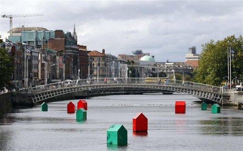 An art installation of Monopoly houses and hotels by Irish contemporary artist Fergal McCarthy floats on the River Liffey in Dublin, in this