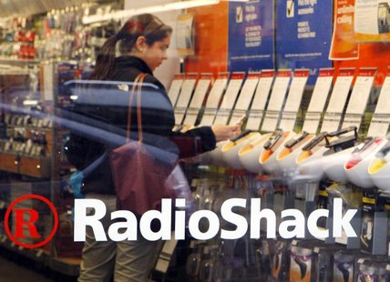 A shopper looks over the mobile phones displayed at a Radio Shack store in Cambridge, Massachusetts April 28, 2008. The consumer electronics