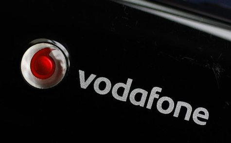 A Vodafone logo is seen on a mobile internet dongle connected to a laptop in London in this November 9, 2010 file photo. REUTERS/Suzanne Plu