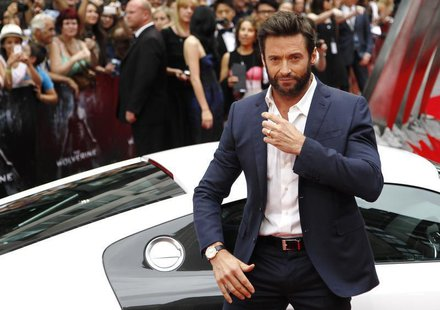 "Actor Hugh Jackman poses as he arrives at the UK Premiere of ""The Wolverine"" at Leicester Square in London July 16, 2013. REUTERS/Luke MacGr"
