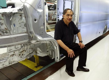 Fiat Chief Executive Sergio Marchionne poses during a visit at the carmaker's Sevelsud plant in Atessa, central Italy, July 9, 2013. REUTERS