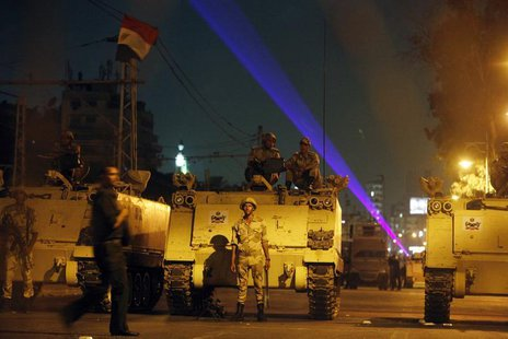 Egyptian Army soldiers stand guard on a road near the presidential palace in Cairo, July 19, 2013, as supporters of deposed president Mohame