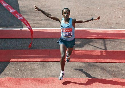 Tsegaye Kebede of Ethiopia wins the London Marathon on the Mall in central London, April 21, 2013. REUTERS/Andrew Winning