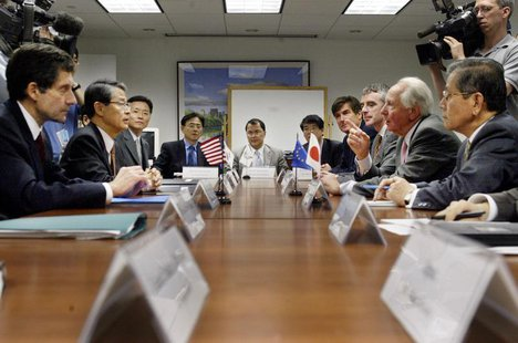 The Executive Board of the Korean Peninsula Energy Developement Organization (KEDO) including Joseph DeTrani (L) of the United States, Sun-S