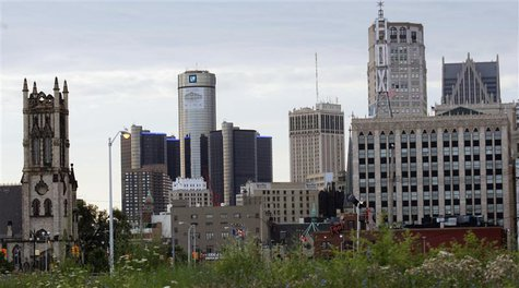Downtown Detroit, including the General Motors World Headquarters (2nd L), is pictured from a vacant lot along Woodward Avenue in Detroit, M