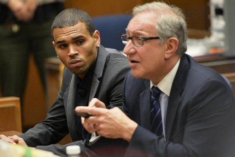 Singer Chris Brown (L) and attorney Mark Geragos attend a probation progress hearing in Los Angeles Superior Court July 15, 2013. REUTERS/Al
