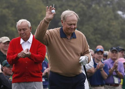 Jack Nicklaus of the U.S. (R) is applauded by Arnold Palmer of the U.S. as he is introduced during the ceremonial start for the 2013 Masters