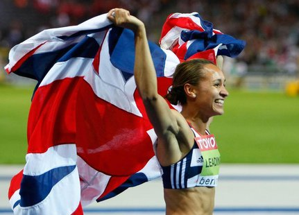 Jessica Ennis of Britain celebrates after winning the women's heptathlon during the world athletics championships at the Olympic stadium in