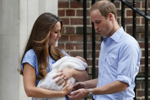 Britain's Prince William and his wife Catherine, Duchess of Cambridge appear with their baby son, as they stand outside the Lindo Wing of St Mary's Hospital, in central London July 23, 2013.   (Reuters)