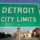 A 'Detroit City Limits' border sign is seen as traffic enters a westside neighborhood in Detroit, Michigan July 22, 2013. Picture taken July