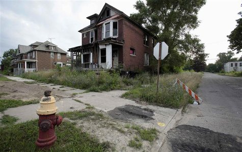 A vacant blighted home is seen on West Grand Boulevard, a once thriving neighborhood, in Detroit, Michigan July 23, 2013. REUTERS/ Rebecca C