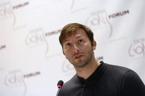 Five-time Olympic gold medallist Australia's Ian Thorpe speaks during the news conference for the Doha Gathering of All Leaders In Sport (GO