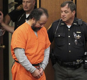 Ariel Castro, 53, walks into the court room with his head down for a pre-trial hearing on charges including rape, kidnapping and murder in C