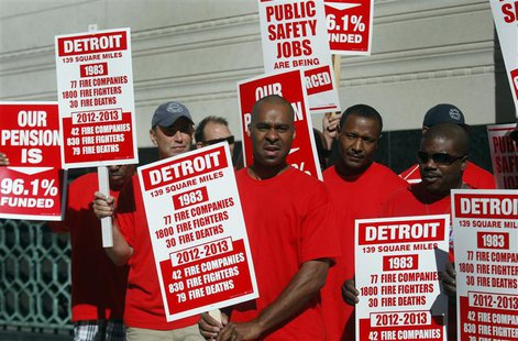 Detroit firefighters hold signs during an informational picket about the downsizing of the fire department outside the federal courthouse du