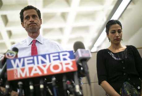 New York mayoral candidate Anthony Weiner and his wife Huma Abedin attend a news conference in New York, July 23, 2013. REUTERS/Eric Thayer