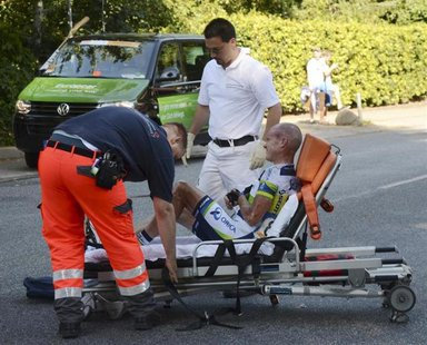 Australian cyclist Stuart O?Grady lies on a stretcher after he crashed during the 245.9km Vattenfall Cyclassics in Hamburg August 19, 2012.