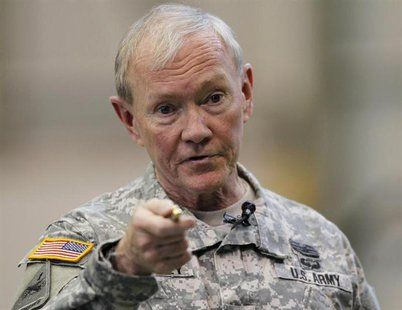 U.S. Chairman of the Joint Chiefs of Staff Army Gen. Martin Dempsey talks to U.S. military personnel stationed at Yokota Air Base in Tokyo A
