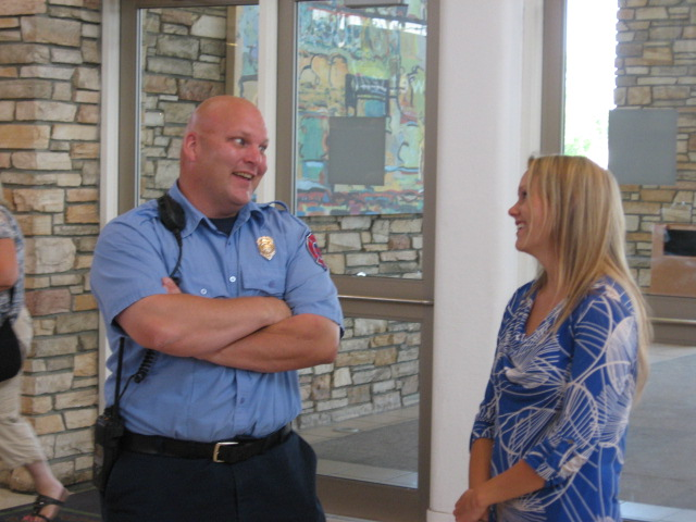 Jeanna Sender of United Blood Services chats with one of Fargo's Firefighter's