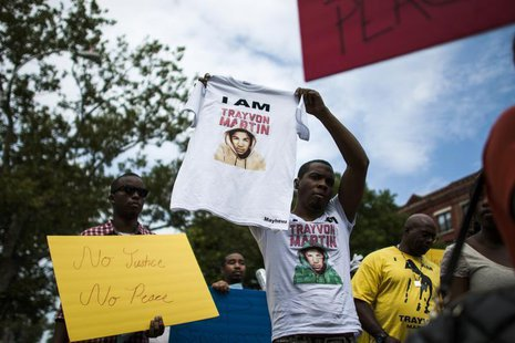 People take part in a march in support of Trayvon Martin's case in Harlem, New York, July 21, 2013. REUTERS/Eduardo Munoz