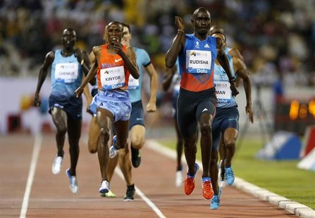 David Rudisha (R) of Kenya leads the men's 800m at the IAAF Diamond League athletics meet in Doha May 10, 2013 file photo. REUTERS/Fadi Al-A