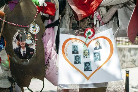 Tributes hang from an olive tree that was planted on D'amelio street in memory of the bomb attack that killed Italian judge Paolo Borsellino