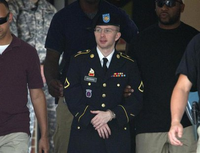 U.S. Army Pfc. Bradley Manning is escorted out of a courthouse at Fort Meade in Maryland, July 18, 2013.REUTERS/Jose Luis Magana